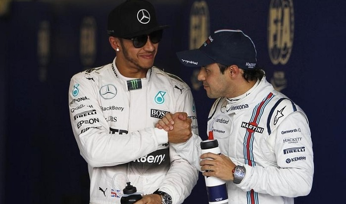 Williams Formula One driver Felipe Massa of Brazil congratulates Mercedes driver Lewis Hamilton of Britain on his pole position after the qualifying session of the Australian F1 Grand Prix at the Albert Park circuit in Melbourne